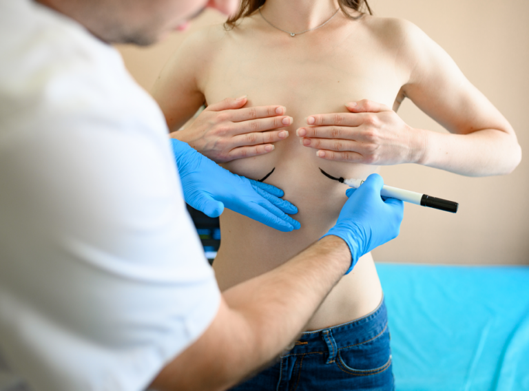 male-surgeon-prepares-woman-for-surgery-in-clinic-TW7VHRQ